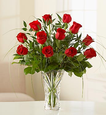 12 Red Roses With Some Ferns In A Vase
