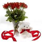 A Bunch of 12 Red Roses and a Small Cute Teddy Bear