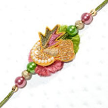 Rakhi-13. This Product Needs To Be Accompanied With Flowers. Please Note That The Color And Design May Vary According To The Availability.