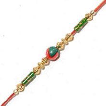 Rakhi-16. This Product Needs To Be Accompanied With Flowers. Please Note That The Color And Design May Vary According To The Availability.