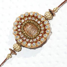 Rakhi-18. This Product Needs To Be Accompanied With Flowers. Please Note That The Color And Design May Vary According To The Availability.