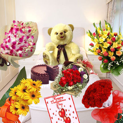 Bunch Of Fresh Orchids, Bunch Of 12 Yellow Gerberas, Bunch Of 12 Red Roses, Bunch Of 24 Red Roses, Basket Of Assorted Flowers, 1 Kg Chocolate Cake, 1.5 Feet Tall Teddy Bear And A Big Card
