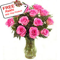 12 Pink Roses In A Vase With A Free Rakhi.