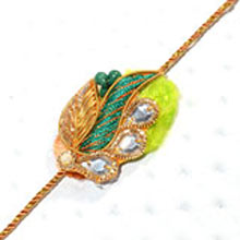 Rakhi-14. This Product Needs To Be Accompanied With Flowers. Please Note That The Color And Design May Vary According To The Availability.
