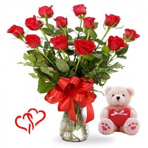12 Red Roses In A Vase And A Medium Size Cute Teddy Bear With A Heart