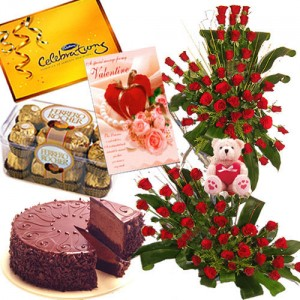 Arrangement Of 150 Red Roses, Small Cute Teddy Bear, 1 Kg Chocolate Cake, Box Of 16 Pieces Ferrero Rocher, Box Of Cadburys Celebration Pack And A Valentine's Day Card
