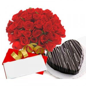 Arrangement Of 24 Red Roses, 1 Kg Heart Shaped Chocolate Cake And A Valentine's Day Card