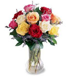 12 Mixed Coloured Roses In A Vase